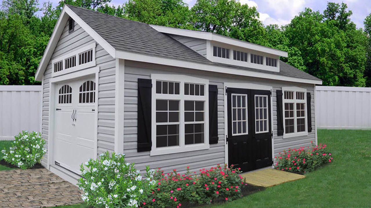 Premier Vinyl Shed with Garage Package, Carriage House Door, Painted 9-Lite Doors, Transom Dormer, and 8' Transom Glass